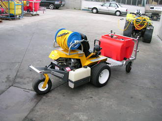 Walker mower with sprayer